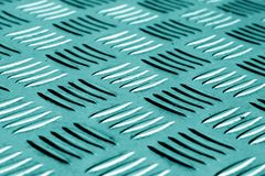 Diamond shaped metal floor pattern with blur effect in cyan tone Royalty Free Stock Images