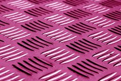 Diamond shaped metal floor pattern with blur effect in pink tone Royalty Free Stock Image