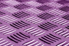 Diamond shaped metal floor pattern with blur effect in purple to Royalty Free Stock Photo