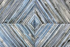 A diamond-shaped pattern of the old wooden boards, grey blue background texture royalty free stock photo