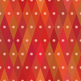 Diamond shaped red seamless pattern with centered dots. Repetitive background for wrapping paper. Template Royalty Free Stock Image