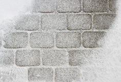 Diamond-shaped tile covered with snow Royalty Free Stock Photo