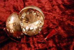 Diamond in silver ball. Diamond with facets that sparkle brightly in the light in silver ball Royalty Free Stock Photography
