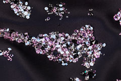 Diamond (small purple jewel) stones over black Royalty Free Stock Photo
