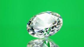 Diamond spinning on green stock footage