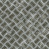 Diamond steel plate useful as a background. Seamless diamond steel plate texture. This tiles as a pattern in any direction stock image