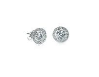 Diamond stud halo set earrings. Beautiful Halo Diamond Stud earrings isolated on white stock photography