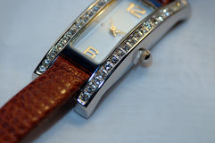 Diamond Studded Watch. Close up of diamond studded watch with leather band royalty free stock photo