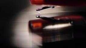 Playing vinyl music. Diamond stylus playing vinyl disk, macro with shallow depth of field stock video