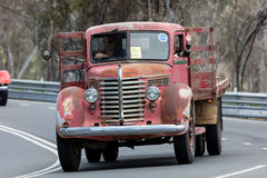 1954 Diamond T 522H Truck driving on country road. Adelaide, Australia - September 25, 2016: Vintage 1954 Diamond T 522H Truck driving on country roads near the Royalty Free Stock Images