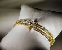 Diamond Tennis Bracelet. Beautiful diamonf tennis bracelet feature two bands and a center stone in yellow gold Royalty Free Stock Image