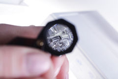 Diamond test by magnifying glass. By jeweller Royalty Free Stock Photos