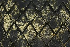 Rubber rhombus on the dock. Diamond texture on an old car tire Royalty Free Stock Photography