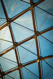 Diamond And Triangle Glass Roof. A detail photo of a transparent glass ceiling with repeating triangle and diamond shaped frame Royalty Free Stock Photos