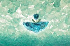 Diamond Tulip with Ice Pieces. Blue diamond cut tulip on a rough ice piece, with transparent stones through back light Royalty Free Stock Photo