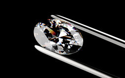Diamond in the tweezers Stock Photo