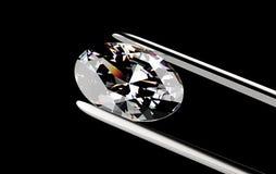 Diamond in the tweezers. On a black background Stock Photo