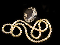 Diamond versus pearls. Diamond and pearls on a black background Royalty Free Stock Photos