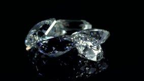 Diamond Video. Diamonds Spinning. Diamond shinning. Diamond Brilliance. Diamond on black background stock footage
