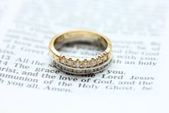 Diamond wedding bands. Two diamond wedding bands for a double bride wedding, on a bible verse Stock Image