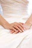 Diamond wedding ring. On bride's finger Stock Photo