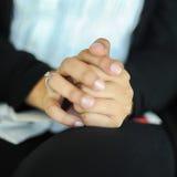 Diamond Wedding Ring On Clasping-Hand Stockbilder