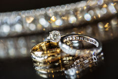 Diamond and Wedding Rings. Macro closeup of wedding rings and engagement ring Stock Photos