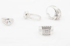 Diamond wedding rings on the white. selective focus Stock Images