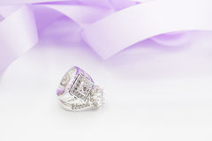Diamond wedding rings on the white. selective focus Royalty Free Stock Images