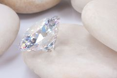 Diamond on white stone Royalty Free Stock Image