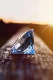Diamond on a wooden beam Royalty Free Stock Image