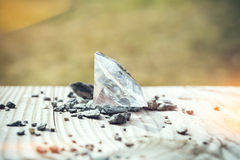 Diamond on a wooden table Stock Photography