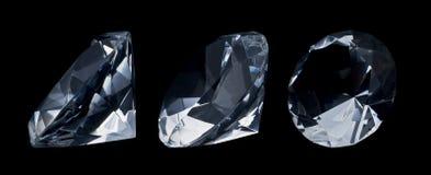 Diamonds. Image of 3 great diamonds on black background stock images