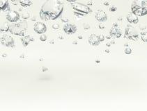 Diamonds. White diamonds on a white background Stock Photos