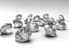Diamonds. Many diamonds isolated on a white plane Stock Photo