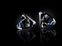 Diamonds. Two loose diamonds on black reflective surface royalty free stock photo
