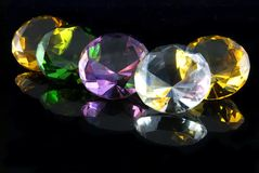 Diamonds. Attractively colored diamonds and gems on a black background Royalty Free Stock Photo