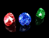 Diamonds 3D. 3d illustration looks many jewels in green, red and blue colors Royalty Free Stock Image