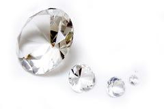 Diamonds. On a white studio background Royalty Free Stock Photo