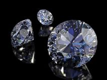 Diamonds. Some perfect diamonds isolated on black background. Clipping Path Stock Image