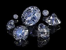 Diamonds. Some perfect diamonds isolated on black background Royalty Free Stock Photo