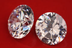 Diamonds. Sparkling on a red background Royalty Free Stock Image