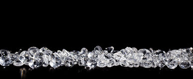 Diamonds on black background stock images