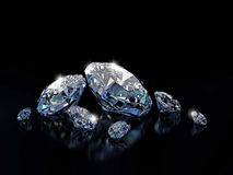 Diamonds on black surface Stock Image