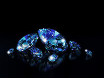 Diamonds on black surface Royalty Free Stock Photos