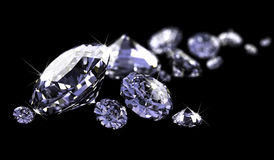 Diamonds on black surface Royalty Free Stock Photography