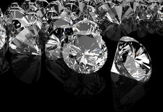 Diamonds on black surface Royalty Free Stock Images