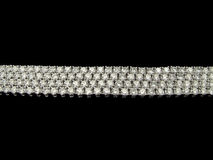 Diamonds bracelets. Four rows of diamonds bracelets on black background Stock Image