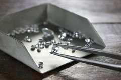 Diamonds. Brilliant cut diamond held by tweezers royalty free stock photography
