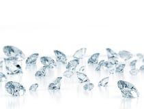 Diamonds close up. On white with slight depth of field Stock Photos